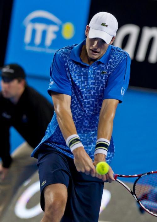 El estadounidense John Isner se enfrentará ante el español Roberto Bautista en una de las semifinales. (Foto: Tony Ashby/AFP)