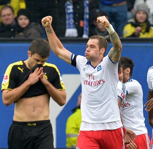 El Borussia Dortmund cayó 3-0 ante el Hamburgo en su último encuentro, correspodiente a la Bundesliga. (Foto: AFP)