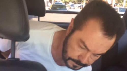 El narco fotografiado minutos después de su captura en Brasil.