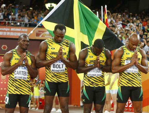 Nesta Carter, Usain Bolt, Nickel Ashmeade y Astafa Powell. El histórico equipo de velocistas de Jamaica. (Foto: EFE)