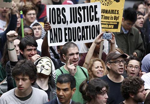 Manifestantes en Wall Street piden justicia, trabajo y educación. (Foto: The Guardian/Jessica Rinaldi)