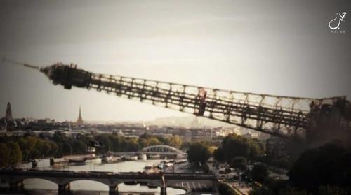 Fotograma del vídeo en el que se simula la caída de la Torre Eiffel como símbolo de la caída de Francia. (Foto: Youtube)