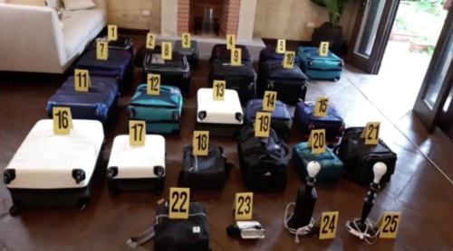 Una fuerte suma de dinero en efectivo fue localizada en varias maletas en una vivienda ubicada en la Antigua Guatemala. (Foto: Archivo/Soy502)