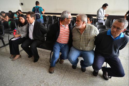 Miguel Lemus, Javier Ortiz y Salvador González en una foto de archivo durante su captura por el caso Bufete de la Impunidad.