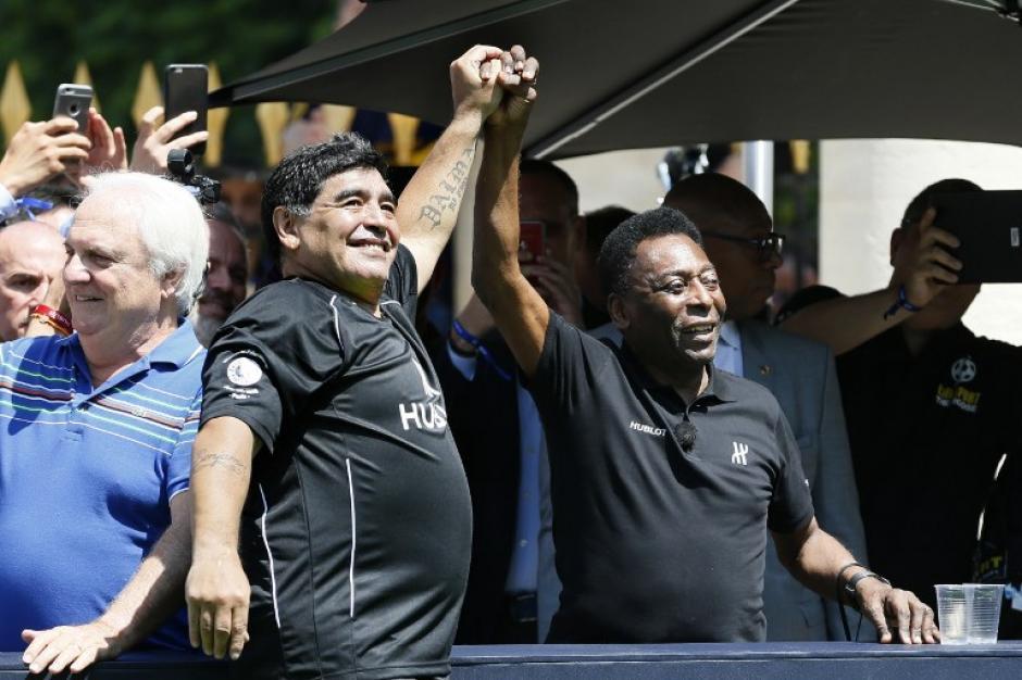 El encuentro fue tomado como un triunfo por ambas estrellas del fútbol. (Foto: AFP)