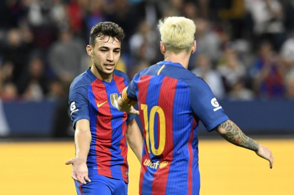 Messi felicita a Munir por uno de sus dos goles. (AFP)