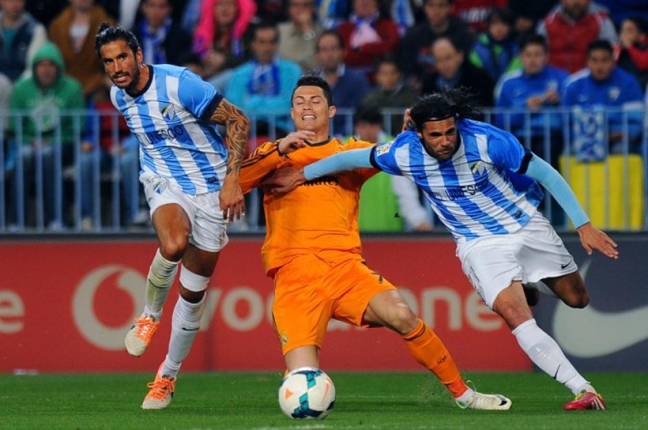 Los andaluces mantuvieron una fuerte marca al delantero Cristiano Ronaldo durante el partico contra el Málaga. (Foto: AFP/Jorge Guerrero)