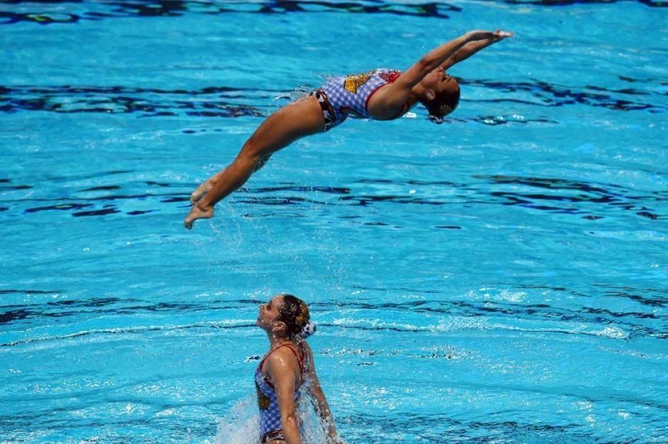 El equipo Méxicano realiza su rutina en la final de nado sincronizado. (Foto: AFP/CHRISTOPHE SIMON)