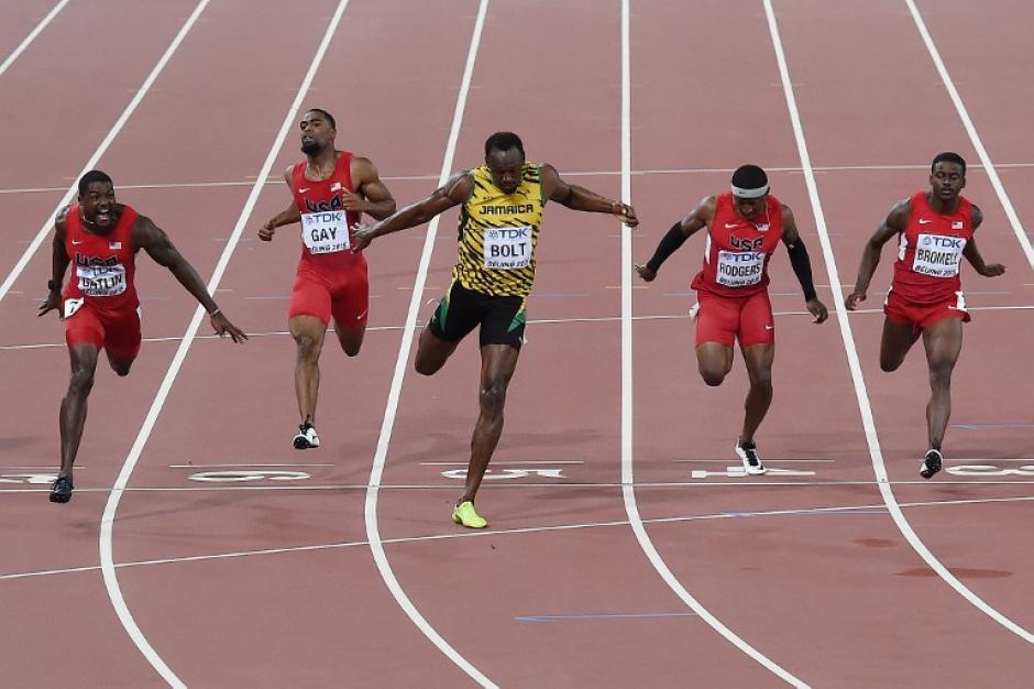 El jamaiquino superó su propia marca y por solo una milésima de segundo quedó primero. (Foto: AFP)