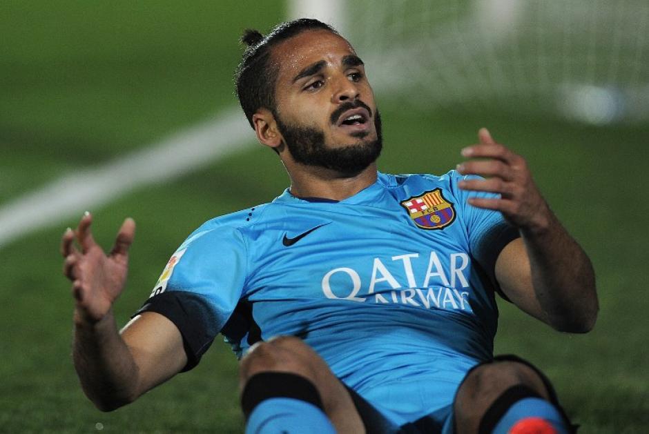 Douglas se lamenta tras caer al suelo. El Barcelona salió con un once plagado de caras nuevas. (Foto: AFP)