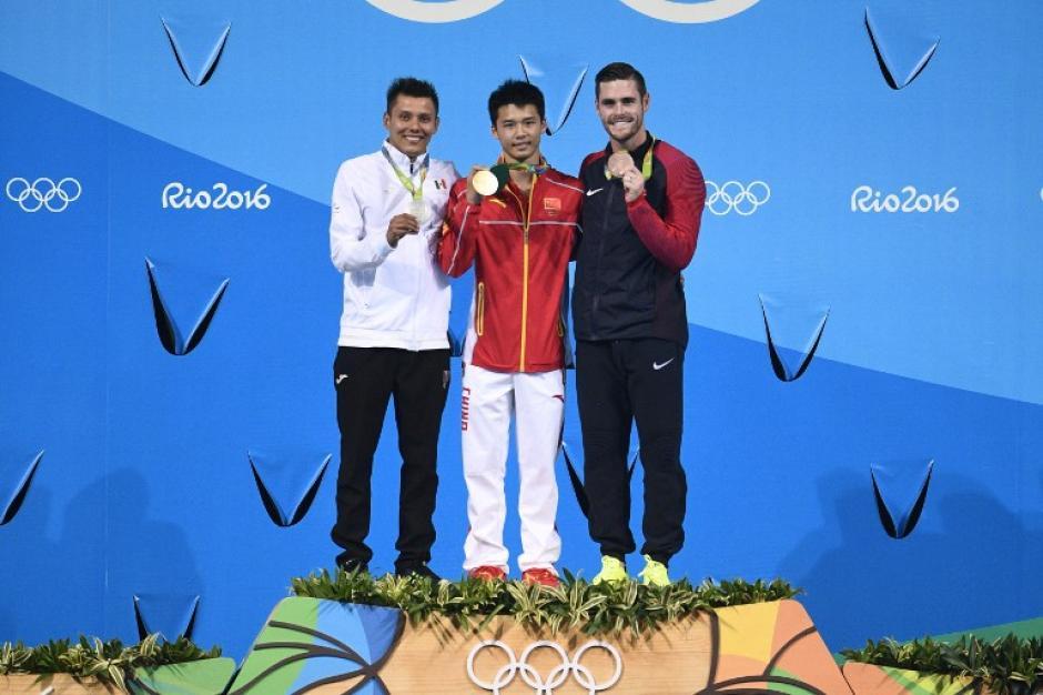 Ellos fueron los ganadores de las medallas en la competencia de clavados. (Foto: AFP)