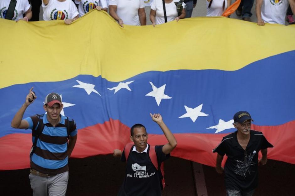 Las banderas de Venezuela fueron parte de la manifestación. (Foto: AFP)