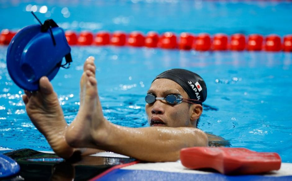 El nadador japonés Tomotaro Nakamura entrena en el centro acuático. (Foto: AFP)