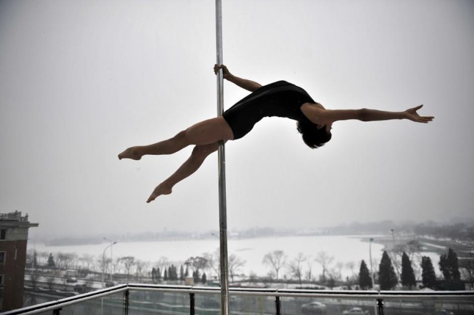 Las estudiantes esperan ser integrantes de la selección nacional china de Pole Dance. (AFP)