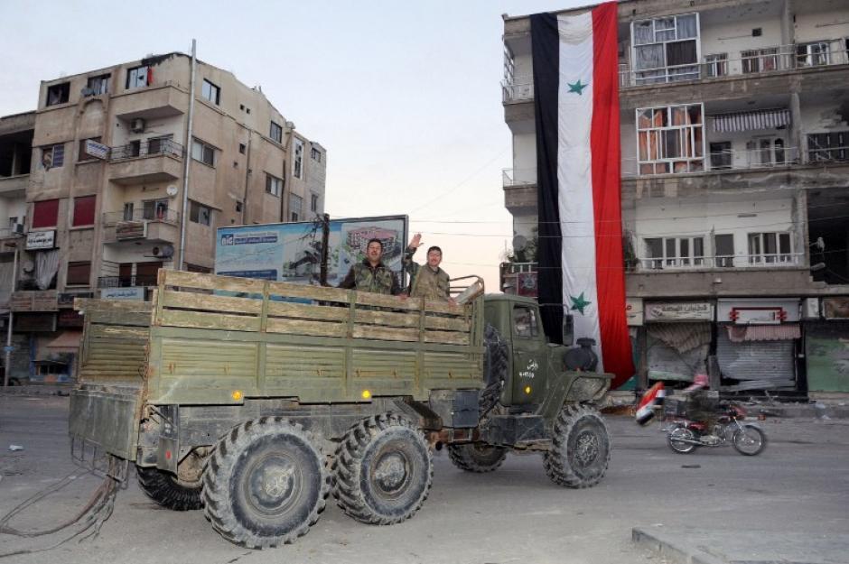 Las fuerzas progubernamentales al tomar la ciudad de Nabak. Foto AFP
