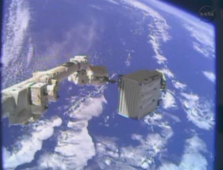 El astronauta Mike Hopkins realiza una caminata espacial en la víspera de Navidad. (Foto: AFP)