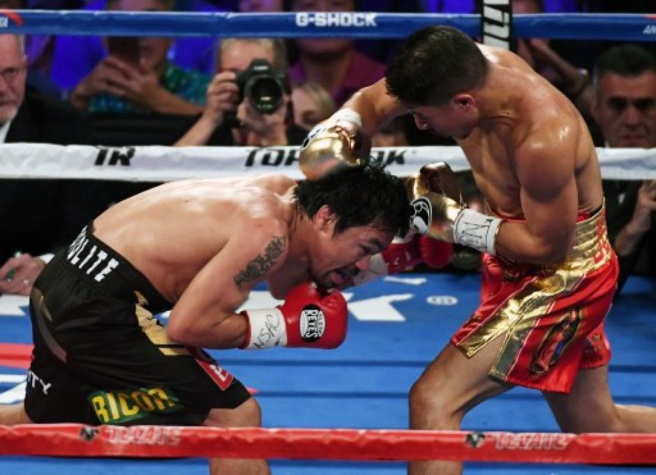 Manny arrebató el título de peso welter, en su versión OMB. (Foto: AFP)