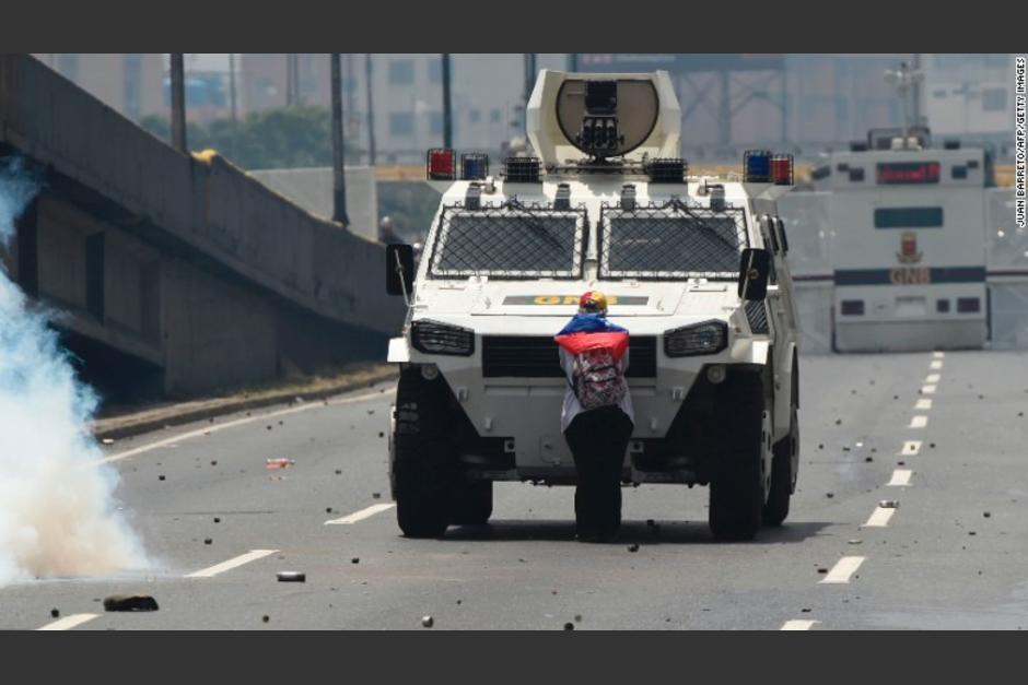 Esta fotografía captada en Venezuela le ha dado la vuelta al mundo. (Foto: Juan Barreto/AFP)