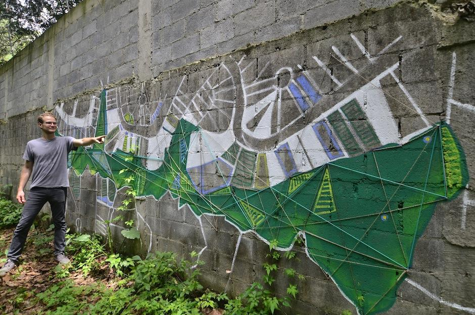 Uno de los murales que divide las dos zonas tiene el mapa del área. (Foto: Selene Mejía/Soy502)