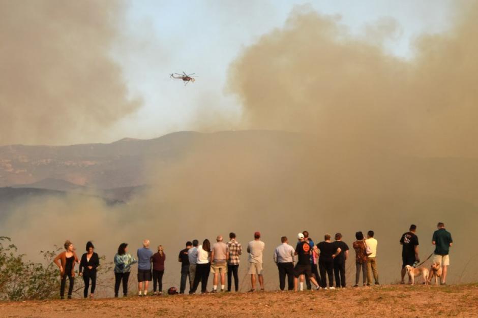 Se reportan 2 mil inmuebles destruidos por los incendios. (Foto: AFP)