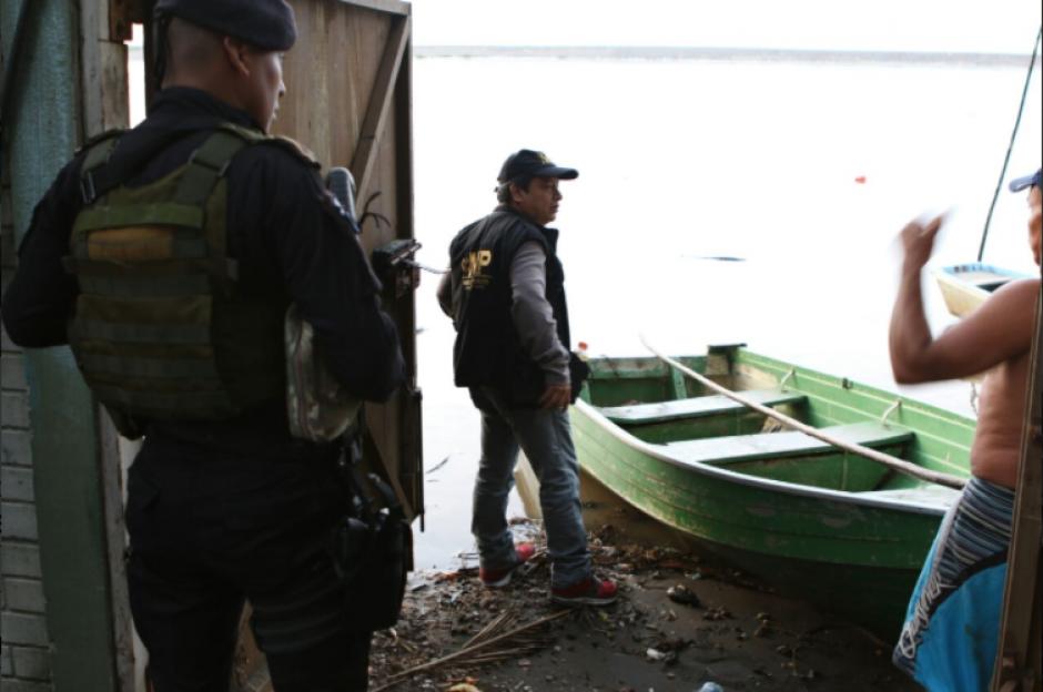 La Fiscalía de Casos Especiales realiza allanamientos en embarcaderos de Puerto Iztapa. (Foto: MP).