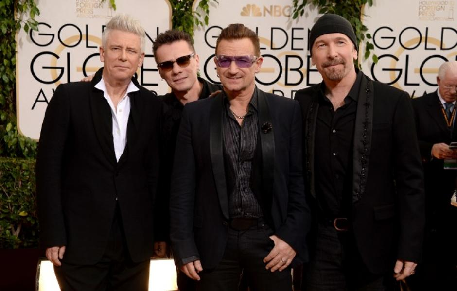 Adam Clayton, Larry Mullen Jr., Bono, and The Edge, del grupo U2. (Foto: AFP)