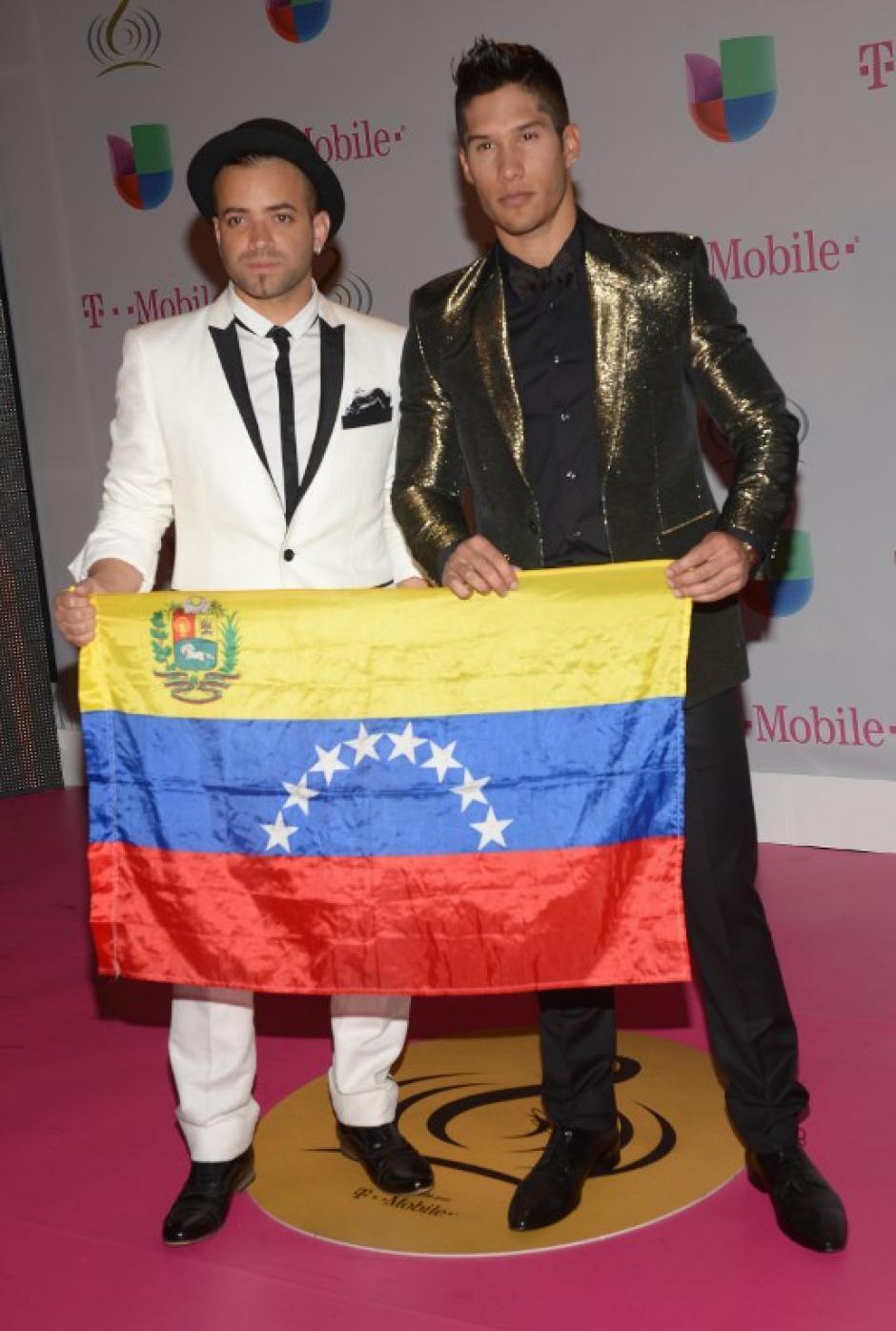 Chino y Nacho expresaron su apoyo en todo momento por su tierra natal, Venezuela. (Foto: AFP)