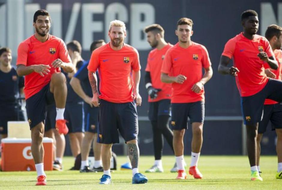 Luis Suárez y Lionel Messi buscarán brillar en el inicio de la Liga. (Foto: AFP)