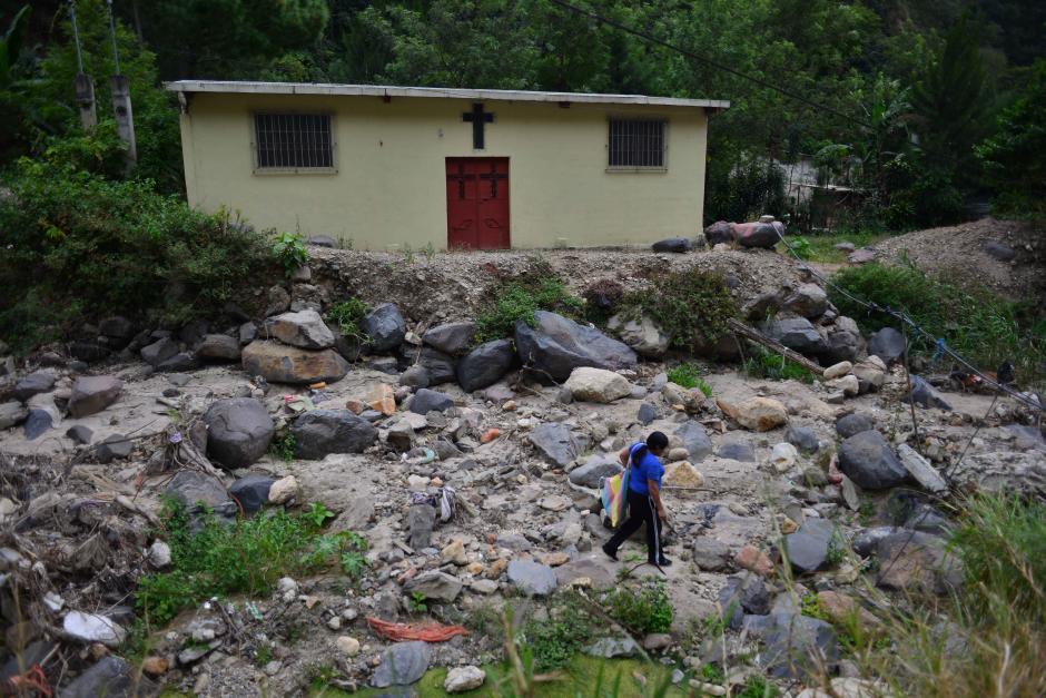 Doña Carmelita lleva 52 años viviendo en el área y pese a ser beneficiaria del subsidio se lo da a su hijo para que alquile. (Foto: Jesús Alfonso/Soy502)