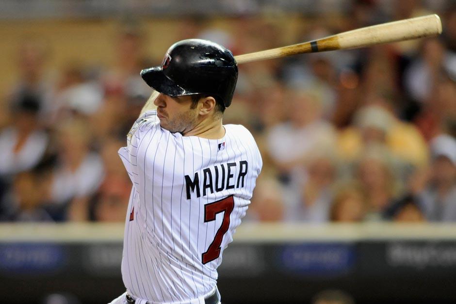 Joe Mauer es un receptor que durante su etapa escolar jugó baloncesto y fútbol americano. (Foto: AFP)