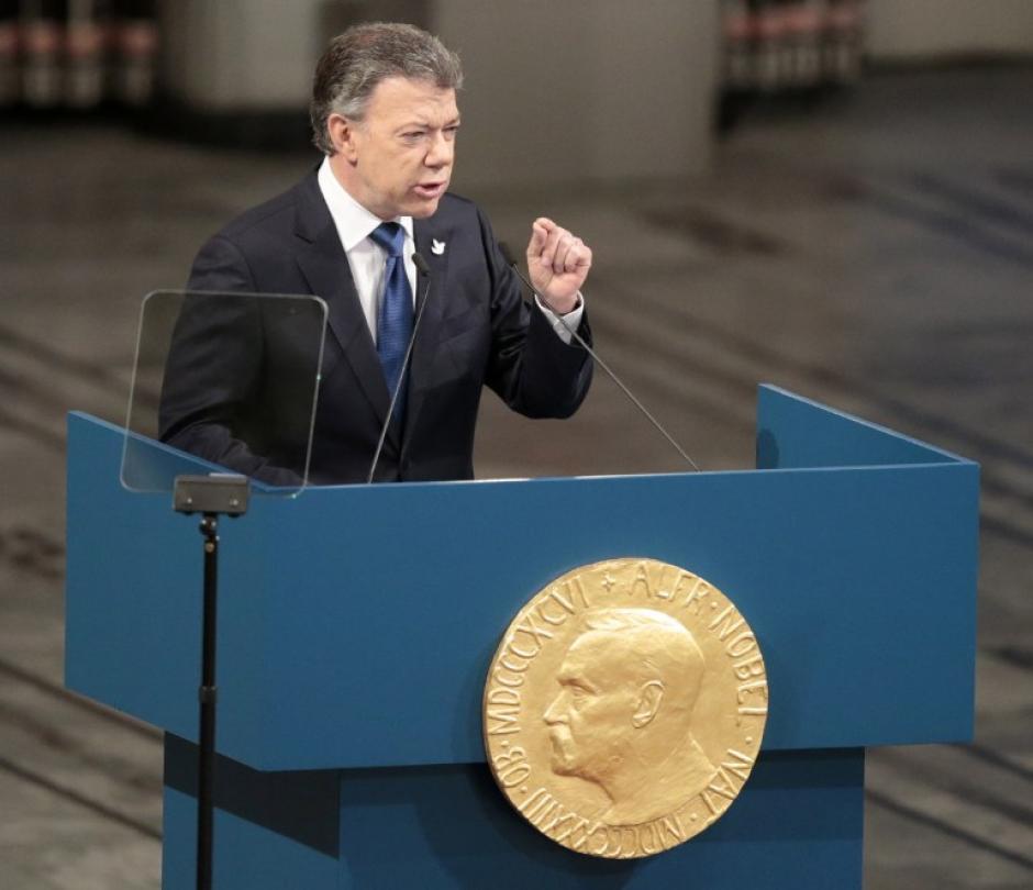 El presidente colombiano terminó un proceso de paz largo y conflictivo, para finalmente firmar un acuerdo de cese al fuego. (Foto: AFP)