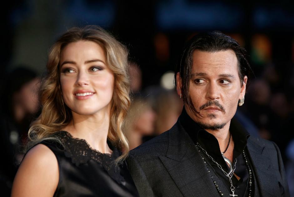 La actriz estadounidense, Amber Heard junto con su marido Johnny Depp. (Foto: laopinion.com)