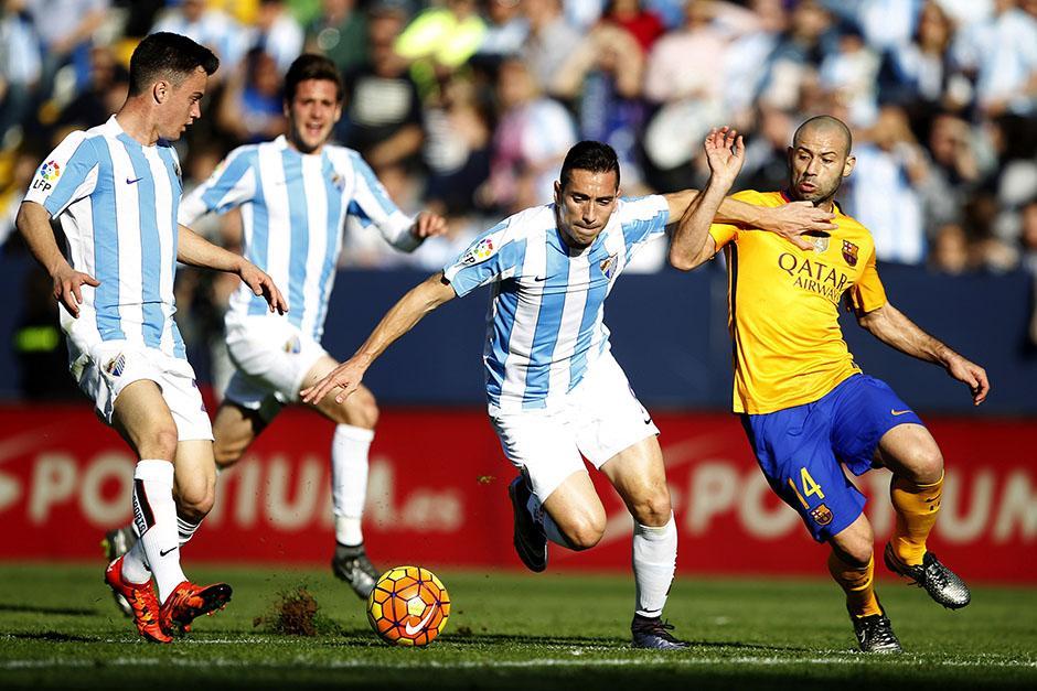 """El argentino Javier Mascherano (14) fue bastión en el medio campo de Barcelona. """"Masche"""" vivió una semana complicada tras enfrentar a la justicia por el tema de evasión fiscal.(Foto: EFE)"""