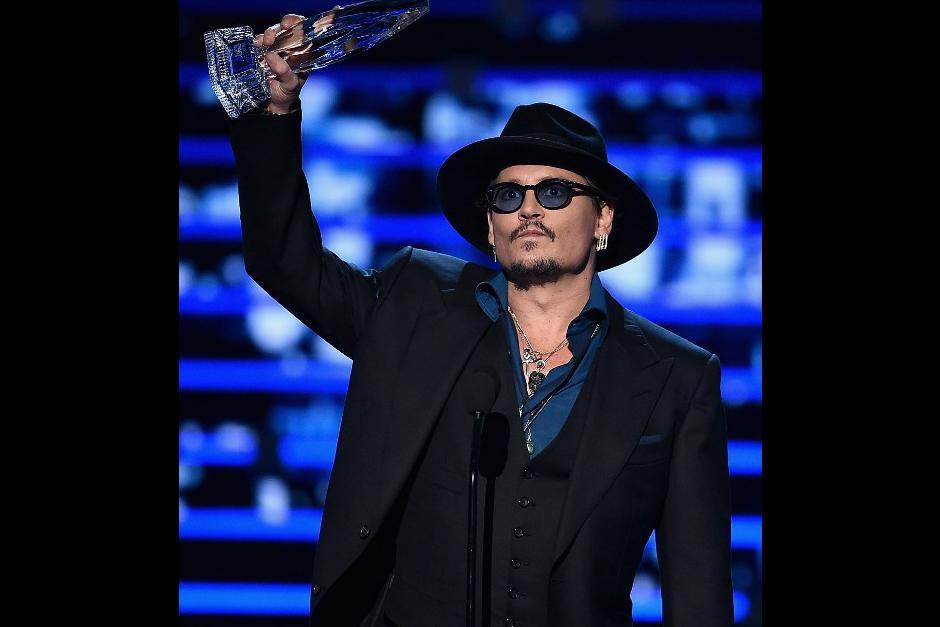 El mejor actor dramático fue para Johnny Depp. (Foto: AFP)