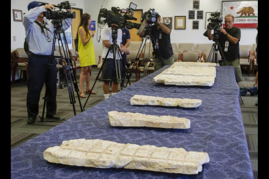 Los arqueólogos que analizaron las esculturas determinaron que coinciden con la iconografía maya. (Foto: LA Times)
