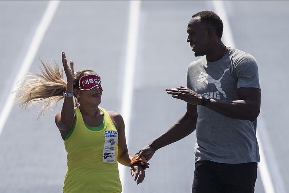 Bolt fue guía de Tereza Guillhermina, la atleta ciega más rápida del mundo (Foto: El Milenio)