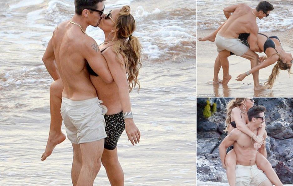 Mariah Carey fue captada besando a uno de sus bailarines cuando ya estaba comprometida con su novio (Foto: usmagazine.com)